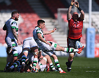 24th April 2021; Kingsholm Stadium, Gloucester, Gloucestershire, England; English Premiership Rugby, Gloucester versus Newcastle Falcons; Louis Schreuder of Newcastle Falcons kicks from a ruck under pressure from Matt Garvey of Gloucester
