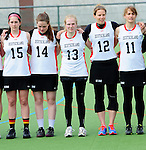 FRANKFURT AM MAIN, GERMANY - April 14: Colleen O'Connor #15 of Germany, Lisa Neubert #14 of Germany, Katharina Schroer #13 of Germany, Eva Schulte #12 of Germany and Julia Duerr #11 of Germany during the national anthem before the Deutschland Lacrosse International Tournament match between Germany vs Great Britain during the on April 14, 2013 in Frankfurt am Main, Germany. Great Britain won, 10-9. (Photo by Dirk Markgraf)