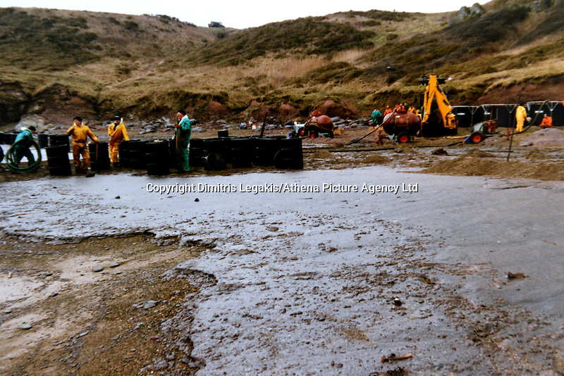 Pictured: Oil on a beach in Pembrokeshire, west Wales<br /> Re: The Sea Empress oil spill occurred at the entrance to the Milford Haven Waterway in Pembrokeshire, Wales on 15th February 1996 which was followed up by a clean up operation has begun