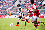 Juventus' player Grigoris Kastanos contests the ball against South China's player Griffiths Ryan Alan during the South China vs Juventus match of the AET International Challenge Cup on 30 July 2016 at Hong Kong Stadium, in Hong Kong, China.  Photo by Marcio Machado / Power Sport Images