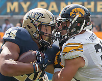 Pitt running back James Conner (24) and Iowa defensive back John Lowdermilk meet face to to face during a tackle by Lowdermilk. Iowa Hawkeyes defeated the Pitt Panthers 24-20 at Heinz Field, Pittsburgh Pennsylvania on September 20, 2014.