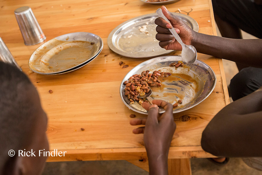 BURUNDI, Ruyigi: 10 June 2015 Ruyigi Re-education Centre Feature.<br /> See accompanying article for general information. <br /> Pictured: Inmates eat lunch - which consists of beans and bread paste. <br /> Rick Findler / Story Picture Agency