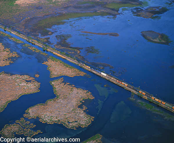 aerial photograph of a train crossing the Mississippi river delta wetlands, Louisiana