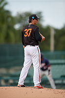 GCL Orioles relief pitcher Yelin Rodriguez (37) looks in for the sign during the first game of a doubleheader against the GCL Twins on August 1, 2018 at CenturyLink Sports Complex Fields in Fort Myers, Florida.  GCL Twins defeated GCL Orioles 7-6 in the completion of a suspended game originally started on July 31st, 2018.  (Mike Janes/Four Seam Images)