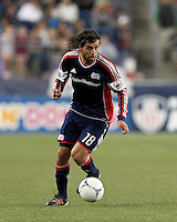 New England Revolution substitute midfielder Juan Toja (18) on the attack. Despite a red-card man advantage, in a Major League Soccer (MLS) match, the New England Revolution tied New York Red Bulls, 1-1, at Gillette Stadium on September 22, 2012.