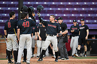 Shortstop Buddy Mrowka (5) of the Harvard Crimson is congratulated by Matt Rothenberg (8) and Jake Forte (40) after hitting a home run in game two of a doubleheader against the Furman Paladins on Friday, March 16, 2018, at Latham Baseball Stadium on the Furman University campus in Greenville, South Carolina. Furman won, 7-6. (Tom Priddy/Four Seam Images)