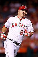 Mike Trout #27 of the Los Angeles Angels runs to first base against the Texas Rangers at Angel Stadium on September 20, 2012 in Anaheim, California. Texas defeated Los Angeles 3-1. (Larry Goren/Four Seam Images)