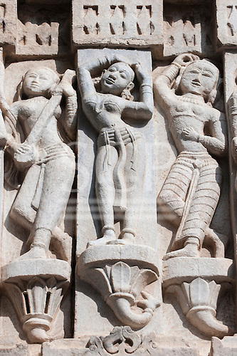 Udaipur, India. 17th century Jagdish Temple, details carved on outside wall, women musicians and dancers.