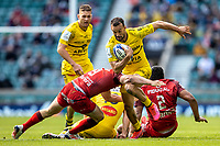 22nd May 2021; Twickenham, London, England; European Rugby Champions Cup Final, La Rochelle versus Toulouse; Dillyn Leyds of La Rochelle is tackled by Antoine Dupont of Toulouse