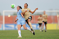 Marta (10) of FC Gold Pride challenges Danielle Johnson (15) of Sky Blue FC for the ball. FC Gold Pride defeated Sky Blue FC 1-0 during a Women's Professional Soccer (WPS) match at Yurcak Field in Piscataway, NJ, on May 1, 2010.