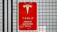 NEWPORT, NJ - AUGUST 31: The TESLA logo is pictured at a charger station on August 31, 2020 in Newport, New Jersey. Tesla shares are more affordable today after their split, which does not make the stock a more attractive investment than it was pre-split price. (Photo by Eduardo MunozAlvarez/VIEWpress)