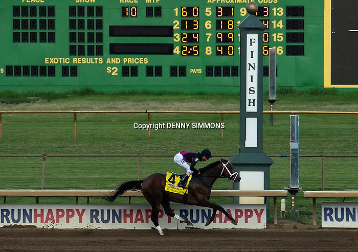 Art Collector, ridden by jockey Brian Hernandez Jr., crosses the finish line of the Runhappy Ellis Park Derby's 10th race for a $200,000 purse at Ellis Park in Henderson, Ky., Sunday afternoon, Aug. 9, 2020. Art Collector won the race handily. The race is a qualifier for the upcoming Sept. 5, 2020, Kentucky Derby, with 85 points (50-20-10-5) up for grabs.