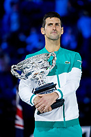 21st February 2021, Melbourne, Victoria, Australia; Novak Djokovic of Serbia holds his trophy after winning the Men's Singles Final of the 2021 Australian Open on February 21 2021, at Melbourne Park in Melbourne, Australia.