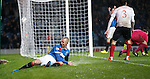 Kenny Miller tries to apply the brakes as he slides off the park after scoring