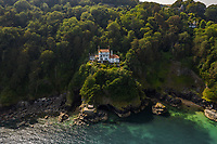 BNPS.co.uk (01202 558833)<br /> Pic: Savills/BNPS<br /> <br /> Standing strong: Bar lodge watching over the waters. <br /> <br /> A breathtaking clifftop home that comes with its own private beach has emerged for sale for an incredible £2m.<br /> <br /> Bar Lodge, which dates back to the Edwardian period, sits in a stunning coastal position right in the mouth of the Salcombe Estuary in Devon.<br /> <br /> It is positioned high above the sea and enjoys unrivaled views right across the picturesque waterway and rocky coastline.