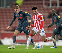 29th December 2020; Bet365 Stadium, Stoke, Staffordshire, England; English Football League Championship Football, Stoke City versus Nottingham Forest; Jacob Brown of Stoke City under pressure from Joe Worrall of Nottingham Forest