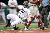 TCU's catcher Bryan Holaday scores against Florida State in Game 1 of the NCAA Division One Men's College World Series on Saturday June 19th, 2010 at Johnny Rosenblatt Stadium in Omaha, Nebraska.  (Photo by Andrew Woolley / Four Seam Images)