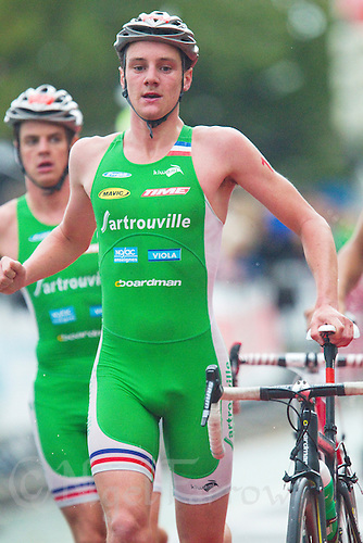 17 SEP 2011 - LA BAULE, FRA - Alistair Brownlee (EC Sartrouville) runs through transition ahead of his brother and team mate Jonathan Brownlee (left) after completing the bike at the final round of the men's French Grand Prix Series at the Triathlon Audencia in La Baule, France (PHOTO (C) NIGEL FARROW)