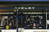 Spectators look on from the main stand during Aveley vs AFC Hornchurch, Emirates FA Cup Preliminary Round Football at the Mill Field on 19th August 2016