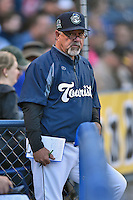 Asheville Tourists pitching coach Mark Brewer (8) during a game against the Hickory Crawdads on April 22, 2015 in Asheville, North Carolina. The Crawdads defeated the Tourists 6-1. (Tony Farlow/Four Seam Images)