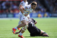 Luke Cowan-Dickie of Exeter Chiefs forces his way past Jacques Burger of Saracens