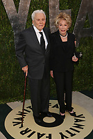 **FILE PHOTO** Anne Douglas Has Passed Away.<br /> <br /> WEST HOLLYWOOD, CA - FEBRUARY 24:  Kirk Douglas and Anne Buydens arriving to the Vanity Fair party after the 85th Academy Awards at the Sunset Tower Hotel in West Hollywood, California. February 24, 2013. <br /> CAP/MPI99<br /> ©MPI99/Capital Pictures