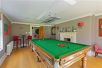 BNPS.co.uk (01202) 558833. <br /> Pic: Savills/BNPS<br /> <br /> Pictured: Games room. <br /> <br /> A wheely rare opportunity...<br /> <br /> A grand country manor with a 300-year-old donkey wheel is on the market for £4.95m.<br /> <br /> The donkey wheel at Annables Manor, one of only two still in existence in England, was built in the 17th century and used to draw water from the 145ft well.<br /> <br /> The Grade II listed manor house near Harpenden, Herts, is one of the finest country houses in the area and as well as its unusual historic feature it has a heated swimming pool and tennis court in its 5.34 acres of land.<br /> <br /> The seven-bedroom home has lots of impressive features including oak beams, open fireplaces and solid oak floors.
