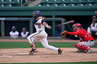 Center fielder Taylor Jackson (15) of the Illinois Fighting Illini bats in a game against the Ohio State Buckeyes on Friday, March 5, 2021, at Fluor Field at the West End in Greenville, South Carolina. The Ohio State catcher is Brent Todys. (Tom Priddy/Four Seam Images)