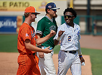 Spruce Creek Hawks Brandon Neely (5) fist bumps John Carroll Catholic Rams Jay Allen (2) during the 42nd Annual FACA All-Star Baseball Classic on June 6, 2021 at Joker Marchant Stadium in Lakeland, Florida.  McKeel Academy Wildcats Andrew Sundean (6) is in the center. (Mike Janes/Four Seam Images)