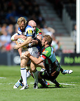 Nick Abendanon of Bath Rugby is tackled by Chris Robshaw and George Robson of Harlequins during the Aviva Premiership match between Harlequins and Bath Rugby at The Twickenham Stoop on Saturday 10th May 2014 (Photo by Rob Munro)