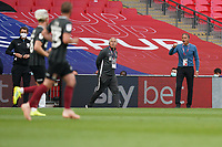Northampton Town manager Keith Curle (right) during the Sky Bet League 2 PLAY-OFF Final match between Exeter City and Northampton Town at Wembley Stadium, London, England on 29 June 2020. Photo by Andy Rowland.
