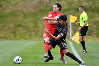 Garbhan Coughlan of Canterbury United competes for the ball with Haris Zeb of Team Wellington during the ISPS Handa Men's Premiership - Team Wellington v Canterbury Utd at David Farrington Park, Wellington on Saturday 19 December 2020.<br /> Copyright photo: Masanori Udagawa /  www.photosport.nz