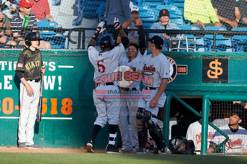 Visalia Rawhide designated hitter Luis Alejandro Basabe (5) is congratulated by teammates Jancarlos Cintron (3) and Renae Martinez (9) after hitting his first home run of the season during a California League game against the San Jose Giants on April 13, 2019 at San Jose Municipal Stadium in San Jose, California. Visalia defeated San Jose 4-2. (Zachary Lucy/Four Seam Images)