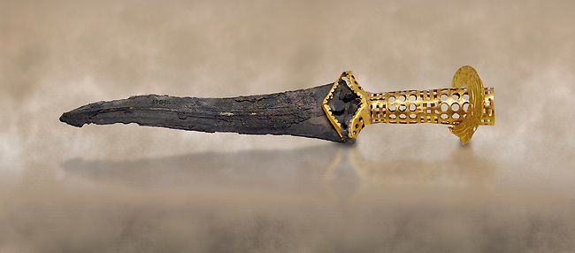 Minoan dagger with elaborate gold perforated hilt , Quartier Mu Malia 1800-1600 BC, Heraklion Archaeological  Museum.<br /> <br /> This dagger would have been a status object signifying rank and authority in the Malia Palace hierachy