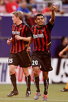 The MetroStars' Amado Guevara celebrates scoring on a penalty kick during first have play between the NY/NJ MetroStars and the L.A. Galaxy during MLS action at Giant's Stadium, East Rutherford, NJ, on August 8, 2004.
