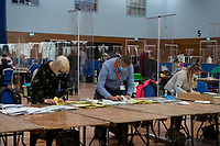 Pictured: A man counts ballot papers during The Swansea East and Gower Election Count at LC in Swansea, Wales, UK. Friday 07 May 2020