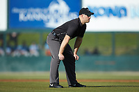Umpire Chris Silvestri handles the calls on the bases during the South Atlantic League game between the Hickory Crawdads and the Kannapolis Intimidators at Kannapolis Intimidators Stadium on May 6, 2019 in Kannapolis, North Carolina. The Crawdads defeated the Intimidators 2-1 in game one of a double-header. (Brian Westerholt/Four Seam Images)