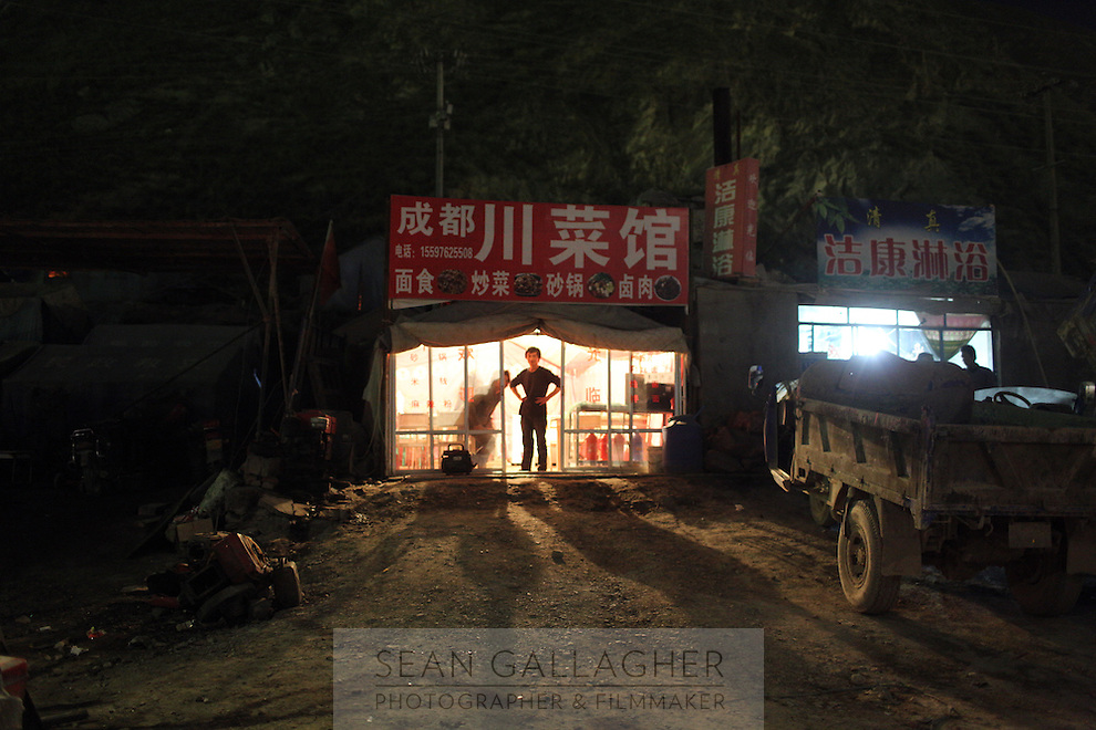 A man stands in the doorway of his tent-restaurant in the ton of Yushu on the Tibetan Plateau, in western China.