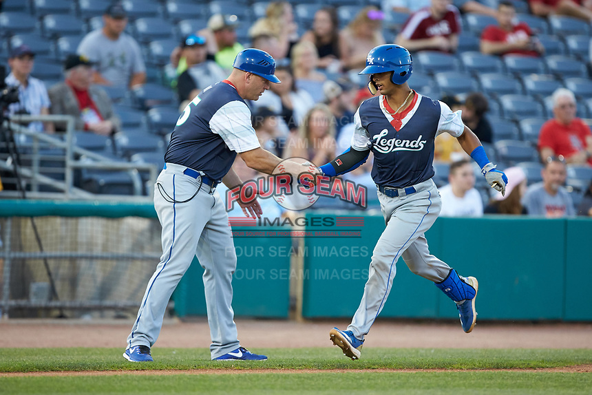MJ Melendez (7) of the Lexington Legends shakes hands with third base coach Scott Thorman (35) after hitting a home run against the West Virginia Power at Appalachian Power Park on June 7, 2018 in Charleston, West Virginia. The Power defeated the Legends 5-1. (Brian Westerholt/Four Seam Images)