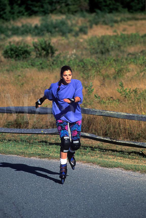 Woman rollerblading.