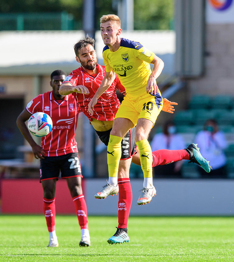 Lincoln City's Adam Jackson vies for possession with Oxford United's Mark Sykes<br /> <br /> Photographer Chris Vaughan/CameraSport<br /> <br /> The EFL Sky Bet League One - Saturday 12th September 2020 - Lincoln City v Oxford United - LNER Stadium - Lincoln<br /> <br /> World Copyright © 2020 CameraSport. All rights reserved. 43 Linden Ave. Countesthorpe. Leicester. England. LE8 5PG - Tel: +44 (0) 116 277 4147 - admin@camerasport.com - www.camerasport.com - Lincoln City v Oxford United