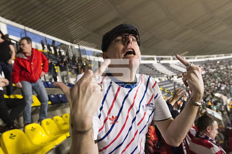 A USA fan heckled by Mexican fans outside the American supporters section protected by Mexican police at Azteca stadium before the USA vs. Mexico World Cup Qualifier in Mexico City, Mexico on March 26, 2013.