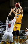 SIOUX FALLS, SD - MARCH 8: Sam Griesel #5 of the North Dakota State Bison shoots a jumper over Kruz Perrott-Hunt #5 of the South Dakota Coyotes during the Summit League Basketball Tournament at the Sanford Pentagon in Sioux Falls, SD. (Photo by Dave Eggen/Inertia)