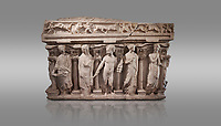 "Roman relief sculpted sarcophagus with kline couch lid, ""Columned Sarcophagi of Asia Minor"" style typical of Sidamara, 3rd Century AD, Konya Archaeological Museum, Turkey. Against a grey background"