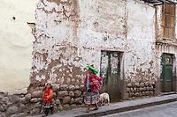 Peru, Cusco.  Quechua Mother and Daughter in Cusco Street.