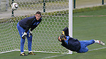 Netherlands' goalkeeper Maarten Stekelenburg (L) eyes the ball as stand-by goalkeeper Michel Vorm stops a ball during a soccer training session at the Athlone stadium in Cape Town July 5, 2010. REUTERS/Michael Kooren (SOUTH AFRICA) ...