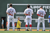 A little boy tentatively looks back into the stands for his parents as he stands with members of the Greenville Drive during the National Anthem before a game against the Lakewood BlueClaws on Sunday, June 26, 2016, at Fluor Field at the West End in Greenville, South Carolina. Greenville won, 2-1. (Tom Priddy/Four Seam Images)