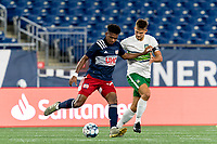 FOXBOROUGH, MA - AUGUST 26: Orlando Sinclair #99 of New England Revolution II passes the ball as Brandon Fricke #15 of Greenville Triumph SC closely defends during a game between Greenville Triumph SC and New England Revolution II at Gillette Stadium on August 26, 2020 in Foxborough, Massachusetts.