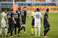 SAN JOSE, CA - OCTOBER 03: Referee Robert Sibiga gives a yellow card to Joe Corona #15 of the Los Angeles Galaxy during a game between Los Angeles Galaxy and San Jose Earthquakes at Earthquakes Stadium on October 03, 2020 in San Jose, California.