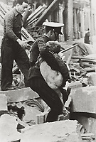 SPAIN. Barcelona. Spanish Civil War (1936-1939). Bombardment of Barcelona (30th January 1938). A child is rescued among the ru